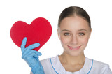 Female doctor in gloves shows a heart symbol
