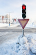 Red traffic light at winter