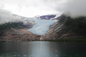 glacier and clouds