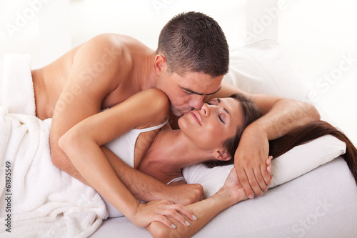 Young man kissing his girlfriend for a good morning.