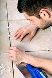 Man laying tiles