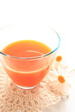 carrot juice on white background with copy space