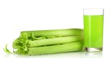 fresh green celery and juice isolated on white.