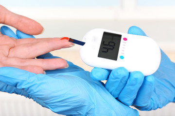 Measuring glucose level blood in hospital close-up