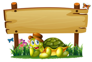 A smiling turtle below the empty wooden board