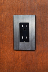 Dual Electrical Outlet on Wooden Wall