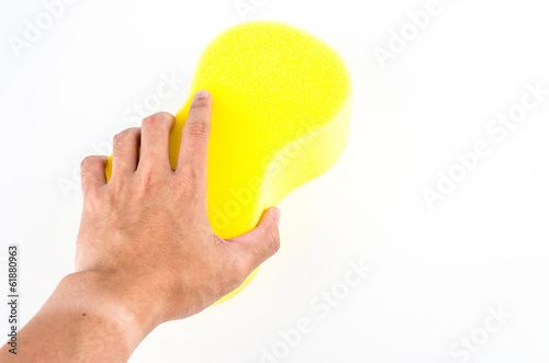Hand holding sponge isolated on white background