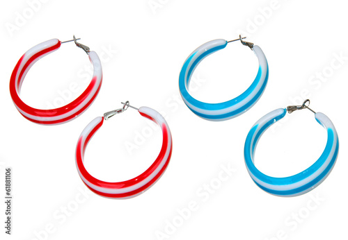 blue and red plastic earrings isolated on white