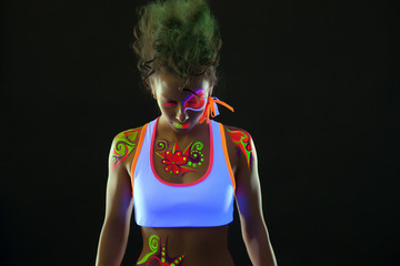 Portrait of cute dancer with fluorescent makeup