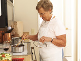 elderly grandmother cooking in the kitchen