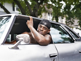 rough african american in old car shirtless
