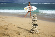Pyramid of the corals and surfer girl with board