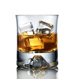 Close up of glass of whiskey isolated on white bckground