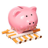 Piggy Bank and Cigarettes isolated on white. Concept of Savings