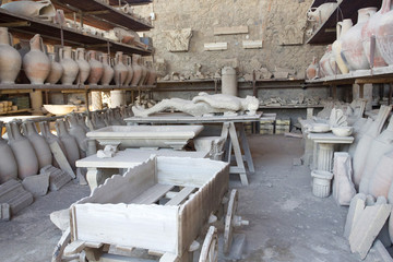 storage sheds in pompeii showing cast of body and pots