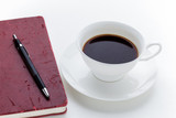 Coffee Cup and grunge red notebook