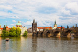 Prague, view of Karlov Bridge and tourists going on it