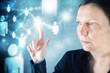 Businesswoman pressing modern display on social networking schem