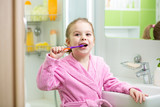 kid brushing teeth