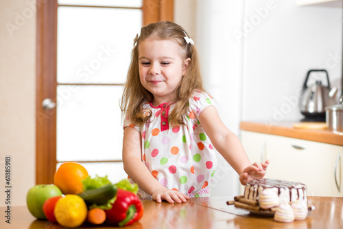child refusing harmful food in favor of vegetables