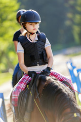 Horse riding, portrait of lovely equestrian on a horse - riding