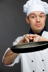 supsised chef holding pan