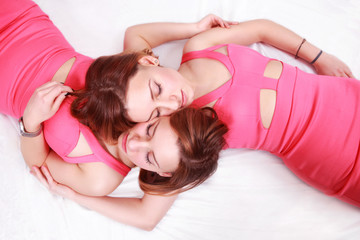 Beautiful women (twins) sleeping close together