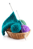 Knitting wool and a few balls in the basket for needlework on a