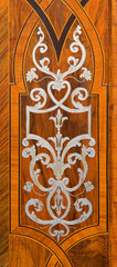 Vienna -  baroque intarsia on door in St. Anne's Church.