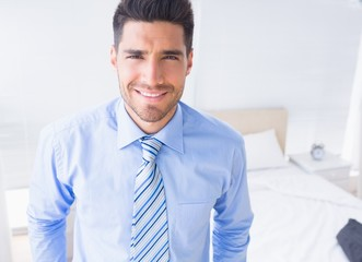 Handsome businessman smiling at camera