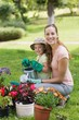 Mother and daughter engaged in gardening