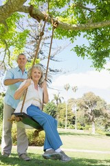 Portrait of a happy mature couple at park