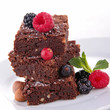 stack of brownies and berries
