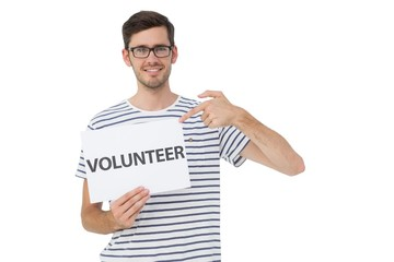 Happy man pointing at donation welcome note
