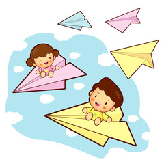 Brother and sister playing in the big a paper airplane.. Home an