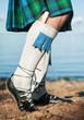 Legs of man in scottish kilt