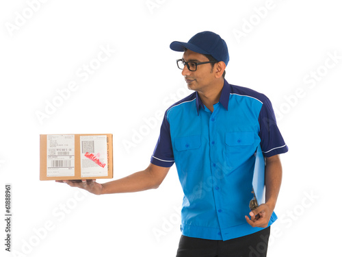 friendly indian delivery man in blue uniform