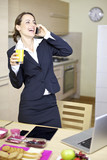 Business woman having fun talking on the phone in the morning