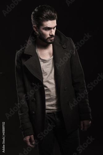 side view of a  casual  man in overcoat looking away