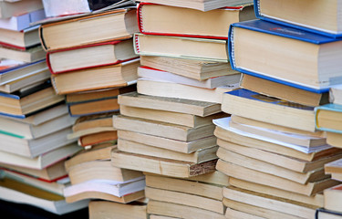 pile of ancient books for sale in the antique shop