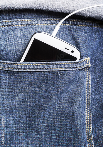 Smartphone in pocket. Everyday use of multimedia