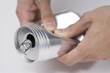 hand of person crushing an empty can