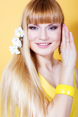 pretty woman with white flowers on yellow background