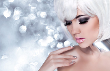 Fashion Blond Girl. Beauty Portrait Woman. Holiday Make-up. Snow