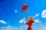 Redhead girl with toy wind turbine