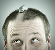 Conceptual image of alternative road for cars on man's head