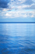 Calm Baltic sea with reflected blue sky
