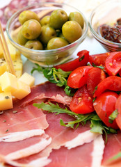 Sliced cold cuts (prosciutto, olives, cheese)