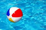 Beach ball in swimming pool