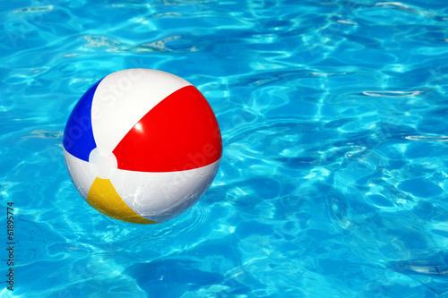 Leinwandbild Motiv Beach ball in swimming pool